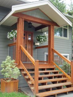 like it ... very small porch & then simple wood stairs. I wonder if we could figure out a small overhang like this on the back of our house that would look good??
