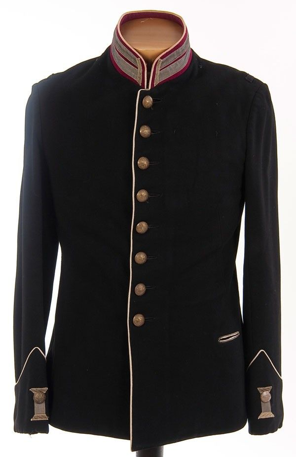 Imperial Russian military tunic, circa 1900.  Dark blue wool with dark red collar and white piping. Has silver bullion Litzen on the collar and cuffs. Lacks shoulder boards. Complete with silvered double headed eagle buttons.