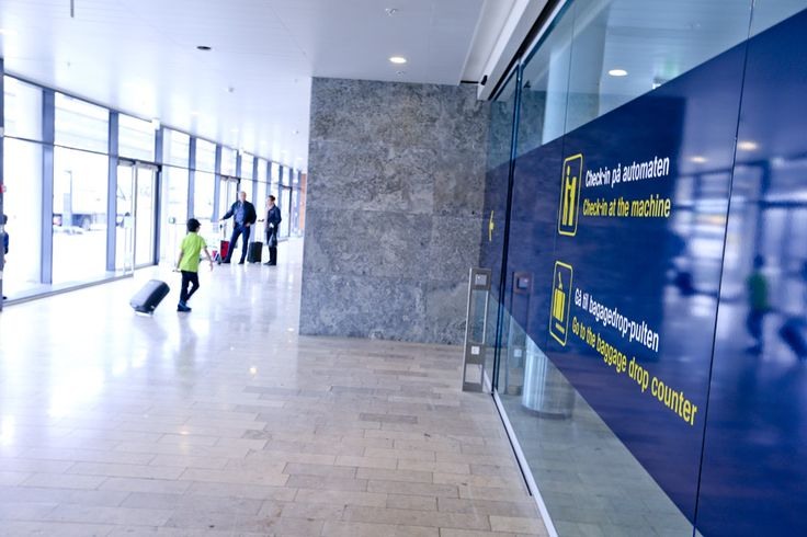 Terminal 2 at Copenhagen Airport. This is the entrance by the new check-in area. In 2012 Terminal 2 was expanded by 1,400 additional squaremeters for the passengers and 12 new check-in desks.