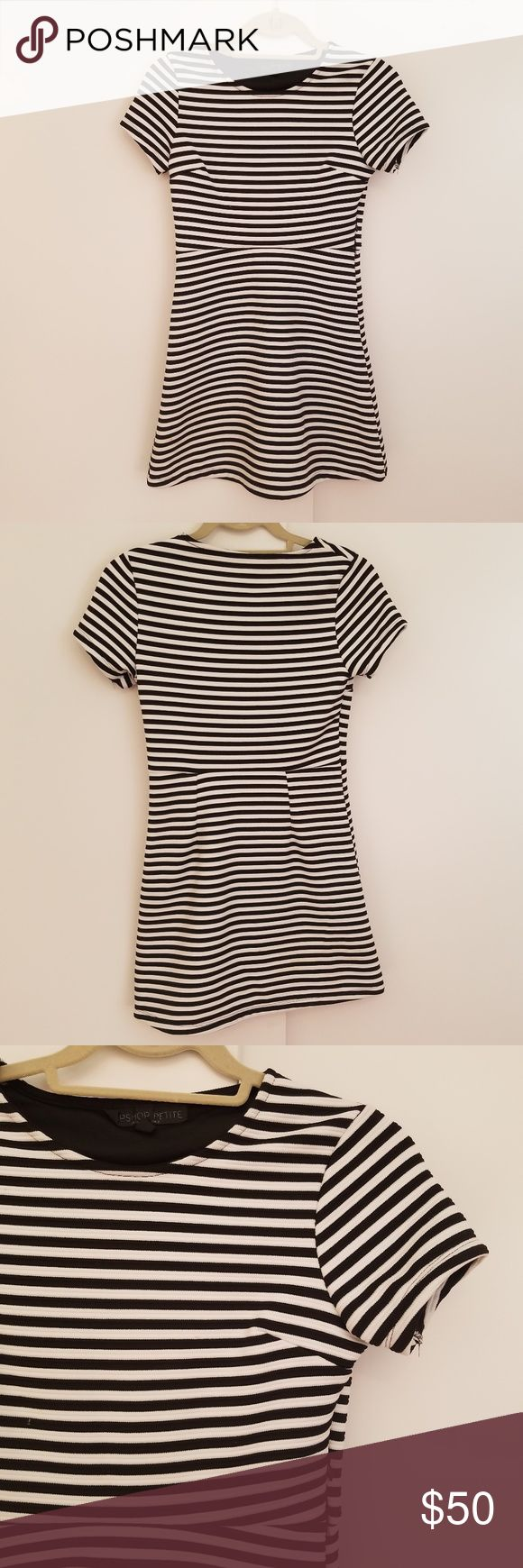 Topshop black white striped dress sz 4 Black and white striped mini dress size 4 petite topshop petite has tiny stain that is not visible when worn (shown in photo) pre-owned but in almost perfect condition short-sleeve  pit to pit: 15 inches length: 29.5 inches Topshop PETITE Dresses Mini
