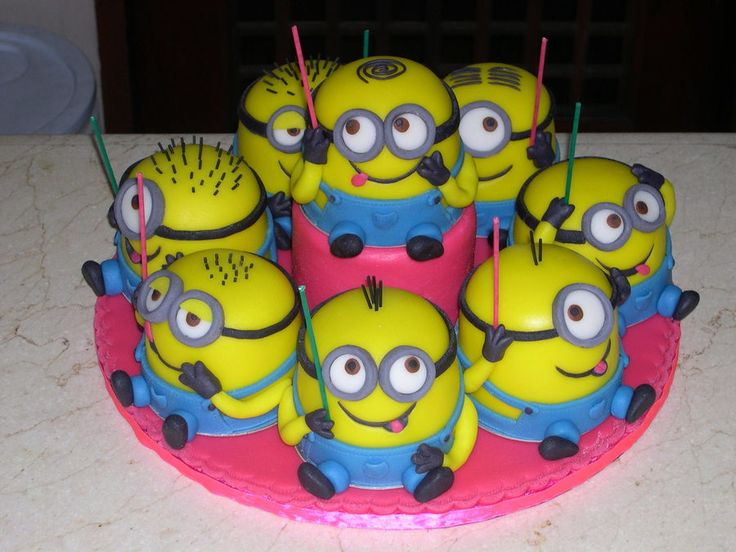 """Minions eight minions for an eight year old girl; baked in 4"""" pans and covered/decorated in fondant"""