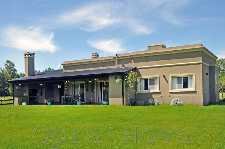 Fachada Contrafrente: Casas de estilo Rural por Opra Nova