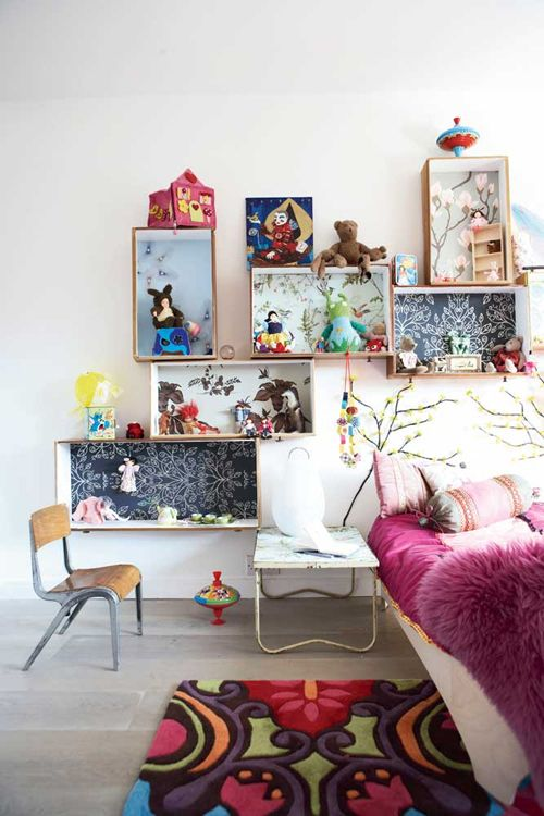 I love how crates have been used as shadow boxes! What an awesome (and easy) DIY Kids Wall Decor (and storage) idea! For more kids wall decor inspiration visit http://kidsroomdecorating.net