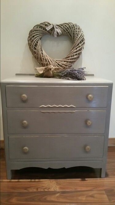 Shabby chic hand painted vintage chest of drawers  painted  in Annie Sloan French Linen. Gold gilding adds to the beauty  and has lovely original  handles painted waxed and gold gilded . Colourmefurniture