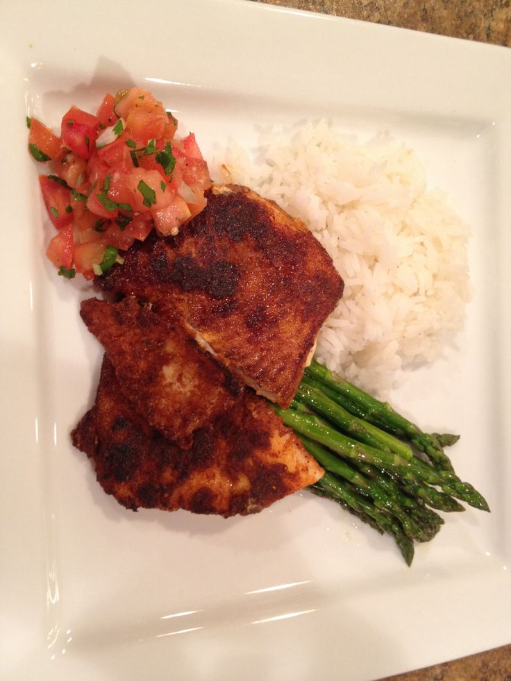 Blackened Haddock with lemongrass tomato salsa.   Dredge haddock in a mixture of 1/4 cup flour, 2 tsp ground cayenne pepper, 2 tsp ground paprika and 2 tsp ground Cajun seasoning.  Put 2 tbsp butter and 2 tbsp canola oil in pan and heat.  Pan fry haddock on each side for 2-3 minutes depending on thickness.  For the salsa.  1 tomato, 1/4 onion, 2 tbsp cilantro, a dash of rice wine vinegar and fish sauce.  1 tsp ground lemongrass and ginger.  Served with rice and asparagus.  So Delicious!