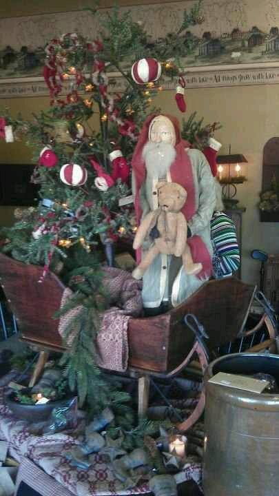 Old Wooden Sleigh...filled with Christmas tree & prim Santa & teddy.
