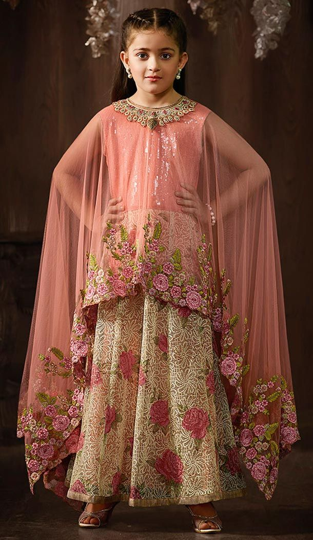 Pamper the women in you with this engaging Cream Color Jacquard,Shimmer Anarkali Style Kids Girl Salwar Kameez. the lovely lace & printed work a substantial attribute of this attire.comes with matching dupatta and matching churidar.