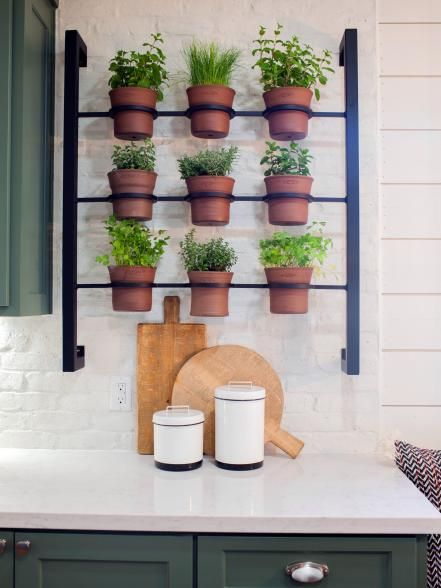 Would love to have in kitchen! From Fixer Upper/ my favorite show...This wall-mounted herb planter in the new kitchen represents the combined efforts of two local artisans – a potter and metalwork specialist.