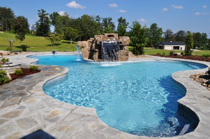 this spectacular swimming pool is a custom designed irregular shaped pool and includes a