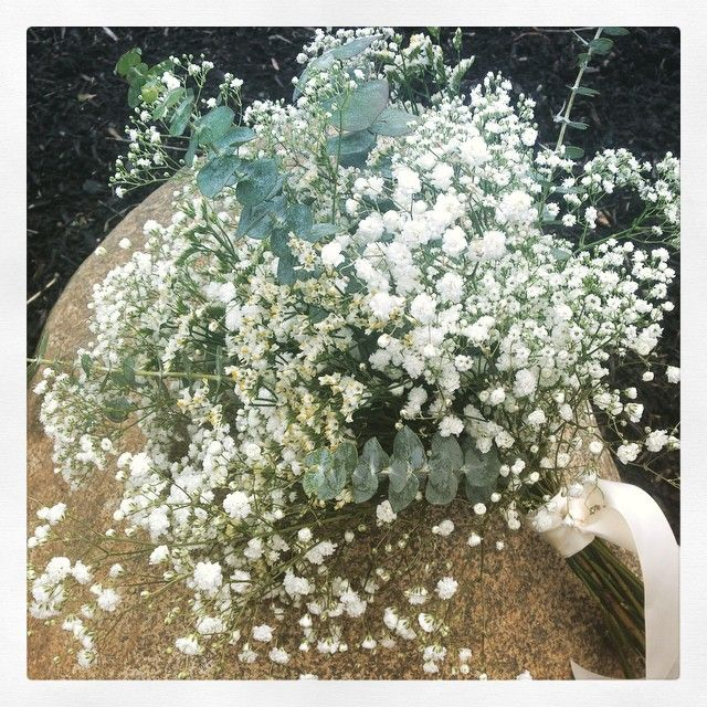 Simple white bridesmaid bouquet with baby's breath and eucalyptus
