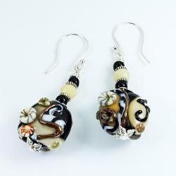 Murano glass Fossil Sea Earring set. Lampworked and specially crafted from Murano glass each piece is unique and truly special.  Our earrings are made with Sterling Silver ear loops.   All findings are Nickle free.  Actual product may differ slightly from the image displayed.