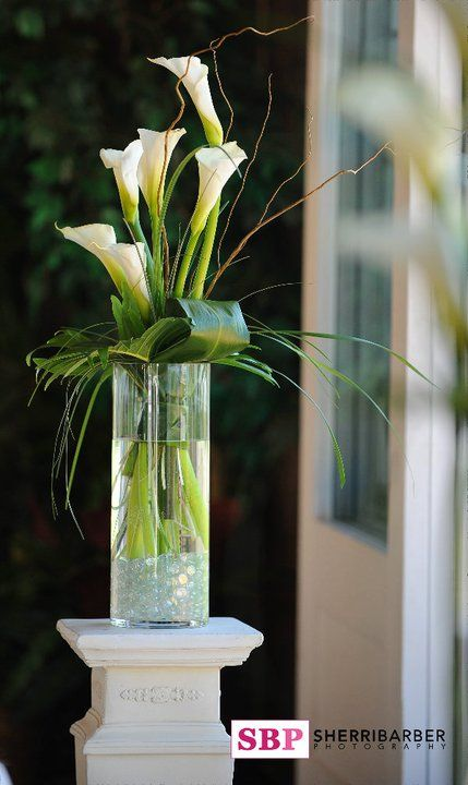 Wedding ceremony alter arrangement with white calla lilies by Best Day Floral Design