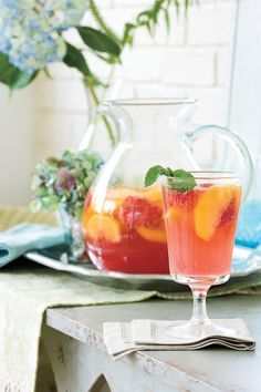 Southern Sangria Recipes - Party-Perfect Sangria Recipes - Southernliving. Recipe: Carolina Peach Sangria  These light and fresh sangria recipes are perfectly pleasing warm-weather libations. Stir up a batch for a refreshing sipper.  This delicious Carolina Peach Sangria calls for fresh peach slices, fresh raspberries, and peach nectar for its fantastic flavor. Be sure to use rosé, not white Zinfandel, in this cool sangria.