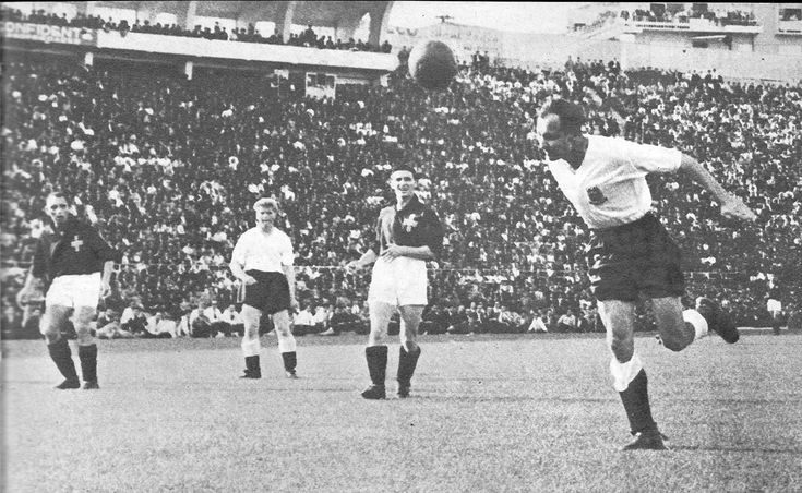 22nd May 1955. England inside left Dennis Wilshaw gets a head to a cross from Roy Bentley but misses the target against Portugal, in Porto.