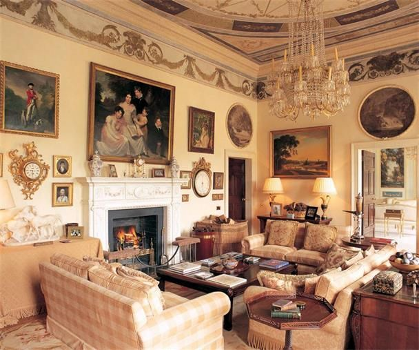 Room of the Day ~ soft yellow color, three sofas, checks, skirted table, large dark coffee table, desk behind sofa, art and clocks on walls, chandelier - Irish decor - splendid! 10.18.2013