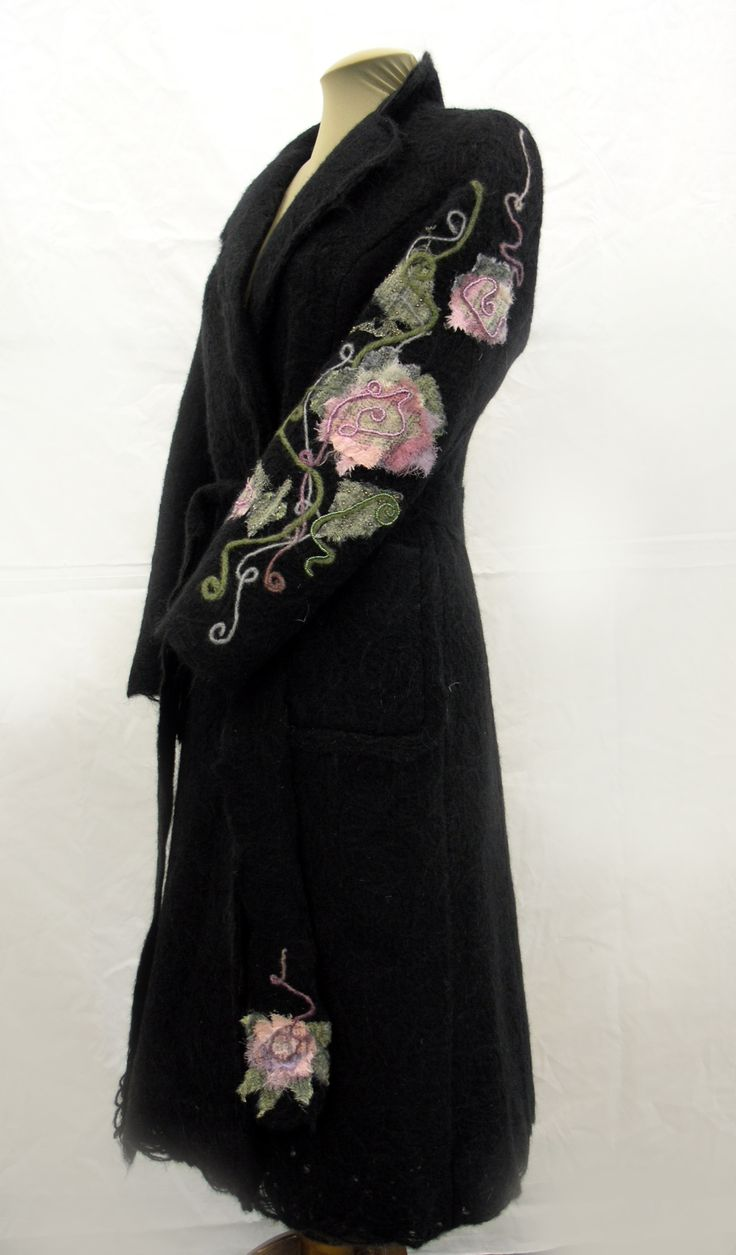 Black coat decorated with fabric flowers