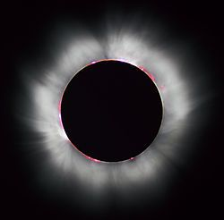 Eclipse - Totality during the 1999 solar eclipse. Solar prominences can be seen along the limb (in red) as well as extensive coronal filaments.