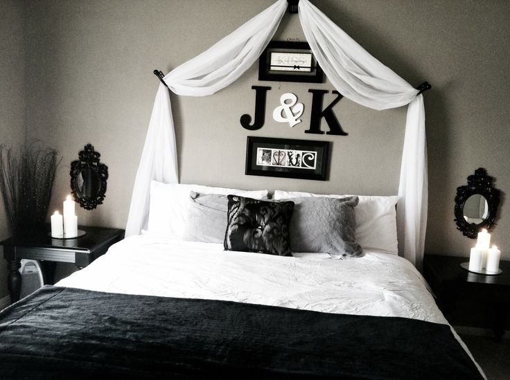 Initials above the bed...