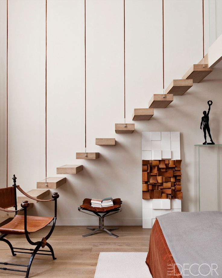 Floating staircase in the master bedroom in a 19th century apartment in the 7th arrondissement of Paris designed by Klavs Rosenfalck