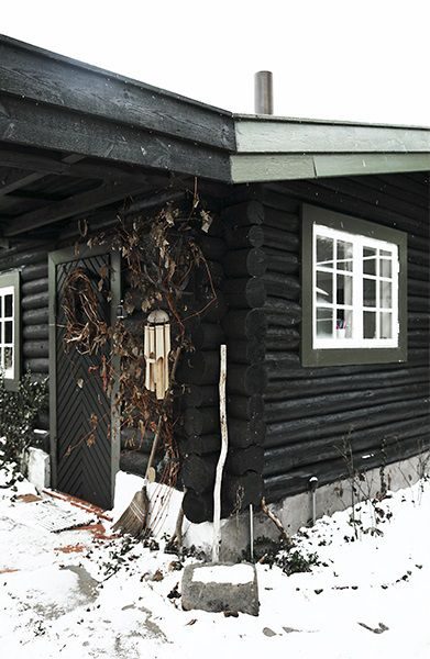 Black painted log cabin, North of Copenhagen, Denmark