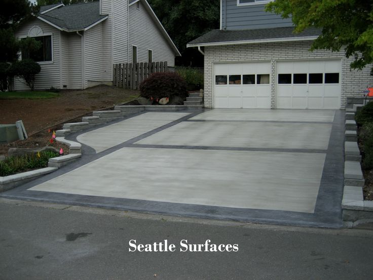Stamped Boarder and Broom Overlay on Exposed Aggregate Driveway Seattle Surfaces (425) 586-0706
