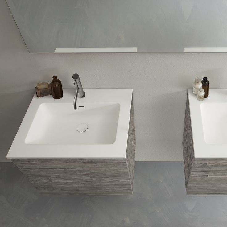 It's all about the materials in this #minimalist #bathroom design, with textured concrete floor, wood grain affect HST vanity finishes and soft, almost warm to the touch blu•stone™ #vanity tops with integrated sinks.