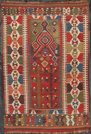 Turkish Kilim shows mithological motifs ilke life tree.