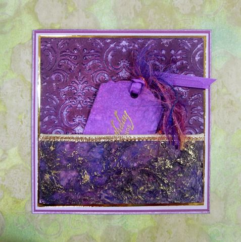 Mixed media birthday card with tag. Resist-embossing, crumpled kitchen paper with inks and gel medium, decorative ribbons and yarns, gilding wax.
