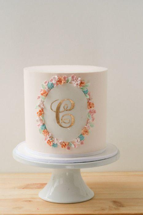 sweet buttercream cake with gold monogram