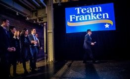 U.S. Sen. Al Franken prepared to thank hundreds of supporters Thursday night in Minneapolis. On the left is his son-in-law Brody Greenwald, wife Franni, daughter Thomasin and son Joe.