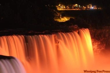 Niagara Falls is illuminated in orange to honour the memory of Jack Layton.