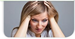 While anxiety can affect anyone, this psychological symptom is two times more common in women than in men and often strikes during the menopausal transition. Though this condition can strike at any time during a woman's life, hormonal changes can produce feelings of anxiety in women going through menopause. A woman wishing to treat anxiety has three categories, or levels, of treatment available to her: (1) Lifestyle Changes, (2) Alternative Medicine and (3) Drugs and Surgery.
