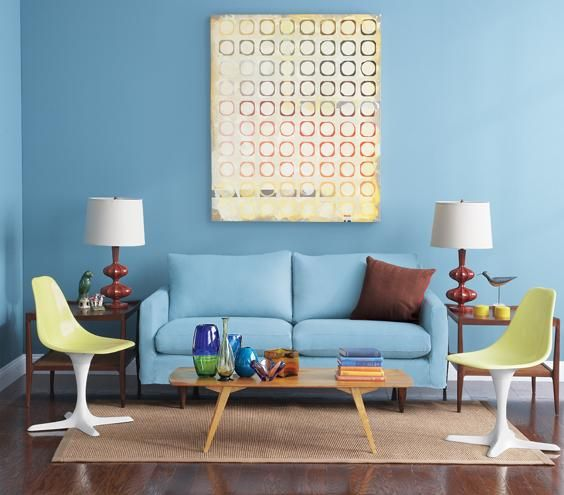 Blue living room with yellow chairs and blue sofa | Surprising, low-cost ways to update your home décor.