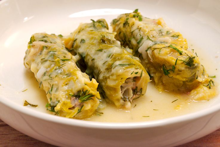 A delicious recipe for Greek stuffed cabbage leaves in an egg and lemon sauce. It's the famous Lahanodolmades with Avgolemono.