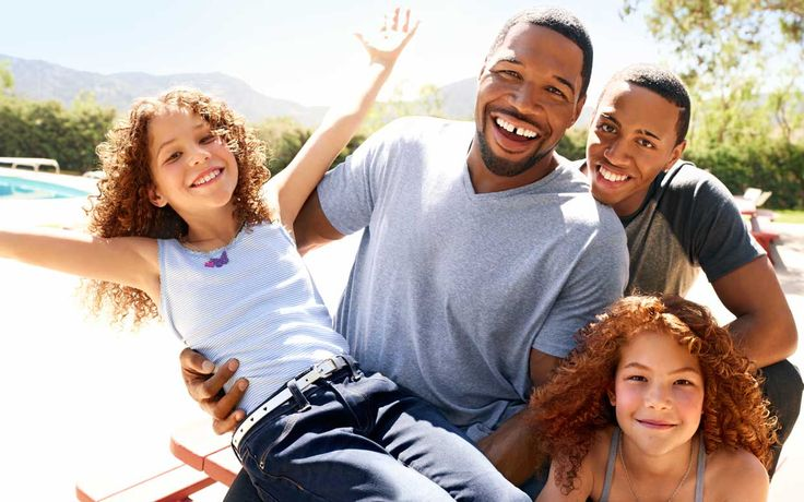 Michael Strahan with his three youngest children (clockwise from left), Sophia, Michael Jr., and Isabella