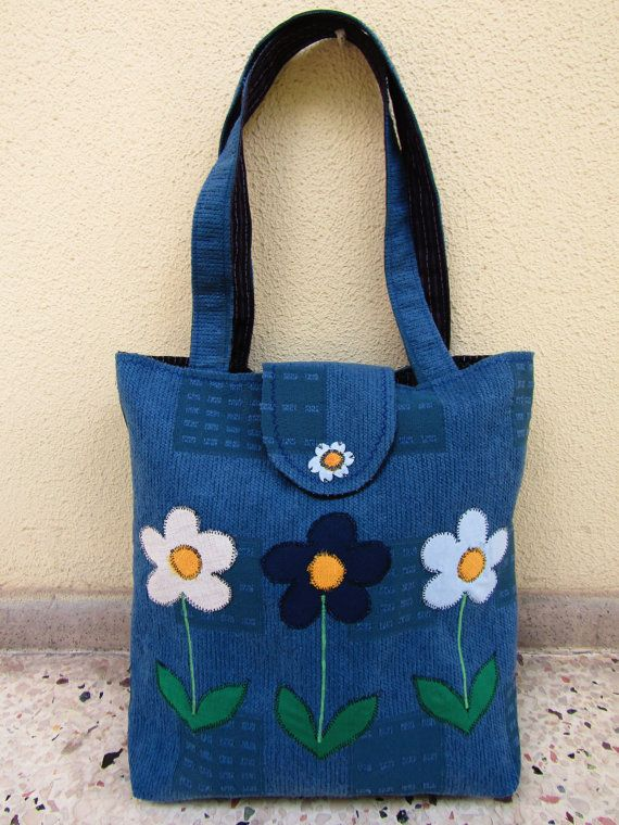 A beautiful and unique large tote bag, made of a strong upholstery fabric, full lined with a striped cotton fabric! The three aplique flowers make the