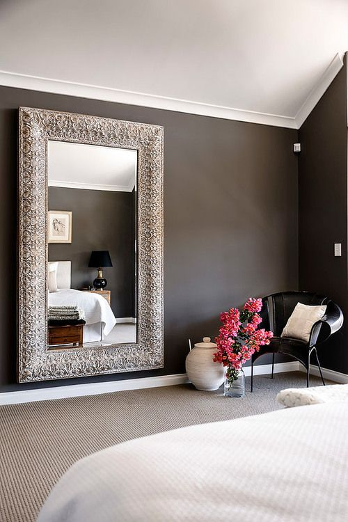 This is absolutely stunning! the mirror, the flowers, the dark wall against  the