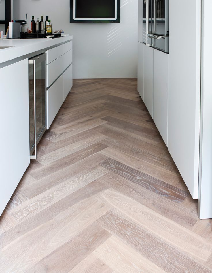 Large herringbone floor design. Would this fit in your kitchen. Think about it.