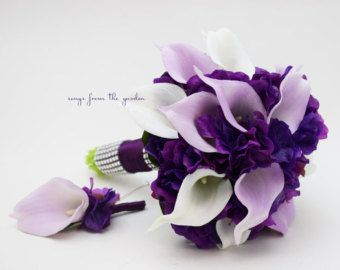 This real touch custom silk flower bridal bouquet of deep purple hydrangea and Picasso Real Touch mini calla lilies can be yours to have and to hold on your destination wedding day! I can create it for you as shown or customize it to fit your color scheme. We can work together to create a custom silk flower wedding package for your entire wedding party with your custom bridal bouquet, grooms boutonniere, bridesmaids bouquets, mothers corsages and more! Contact me today and we can get started…