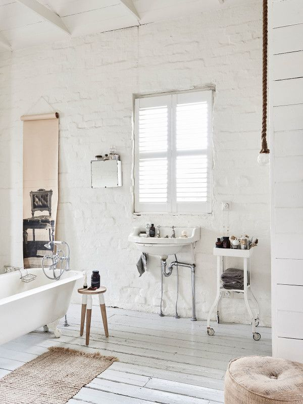 Bathroom in bedroom. Wood stool from Gardener and Marks, Deborah Bowness wallpaper from Gardener and Marks, and an old industrial trolley Lynda bought 20 years ago. Photo – Eve Wilson. Production – Lucy Feagins / The Design Files.