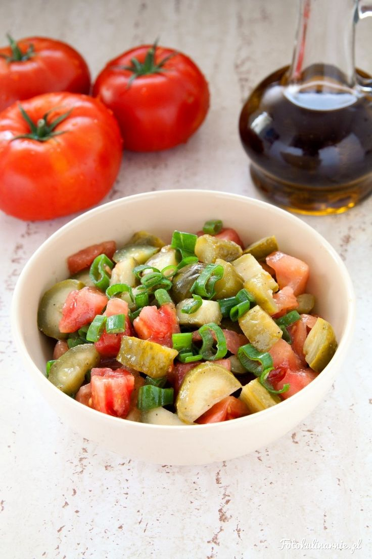 Tomato, pickled cucumbers and spring onions salad.