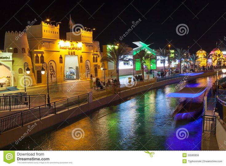 Canal at the Global Village in Dubai illuminated at night