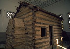 Abraham Lincoln was born Feb. 12, 1809 in a log cabin at Sinking Springs Farm, when that part of Kentucky was still a rugged frontier.  This is the symbolic cabin of Lincoln's birthplace at the National Historic Site.