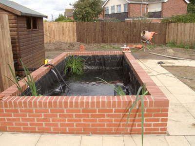Formal koi pond formal brick built koi pond patio for Brick koi pond