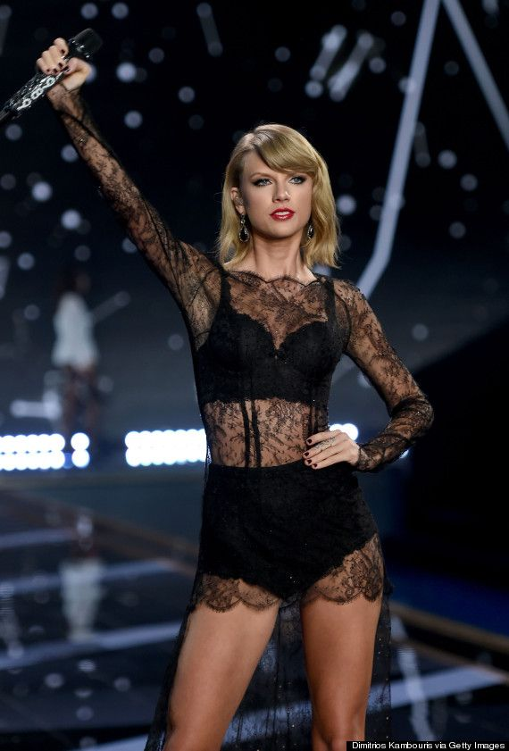 """The """"Blank Space"""" singer Taylor Swift rocked a black bra top and panty combo underneath a lace cover-up on December 2, 2014 at the Victoria's Secret Fashion Show."""