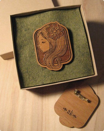 "audrey kawasaki    Laser-Engraved Brooch  engraved brooch with lockable gold pin  2.25"" x 1.75"" on 1/8"" thick alder wood  more info"