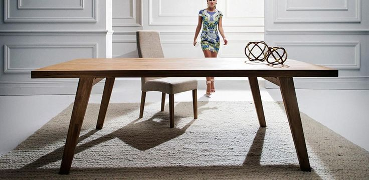 Made from solid Oak timber and treated with an oil, the lustre finish brings out a contrast in the grain and structure. The design with splayed tapered legs gives the table a mid-century look.