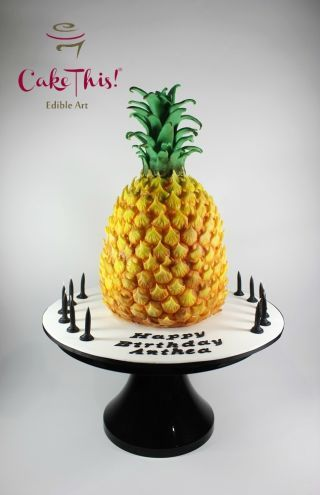 A 3D pineapple cake for a young lady who adores anything and everything pineapple!