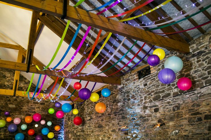 Colourful wedding in the Lake District. Multicoloured lanterns and ribbon. (copyright of ink and pixels creative)