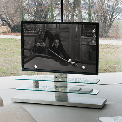 Contemporary TV unit on wheels, the height can be adjusted with cable cover. With stainless steel structure and clear glass shelves. Suitable for flat TVs. Max capacity: total kg 55; glass shelf kg 10.For further information please phone us on 01223327463.